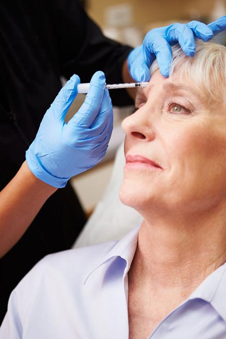 Doctor performing Botox treatment
