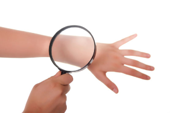Magnifying glass on hand