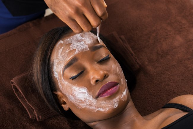Applying Chemical Peel on a women face